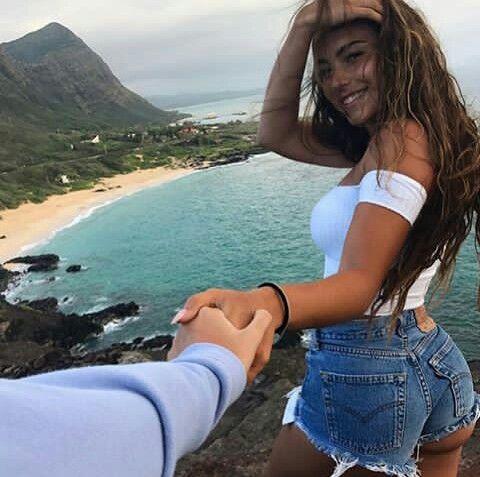 Parejas Goals de la mano en la playa